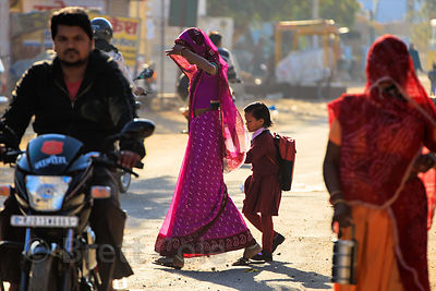 A woman walks her daughter to school, Pushkar, Rajasthan, India