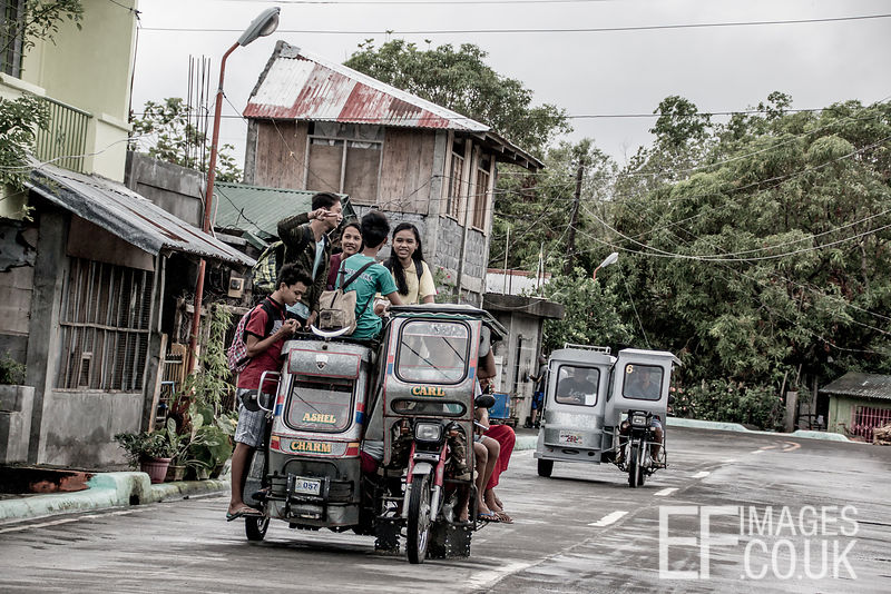 The School Run III - Kids Coming Home From School By Tricycle In The Philippines