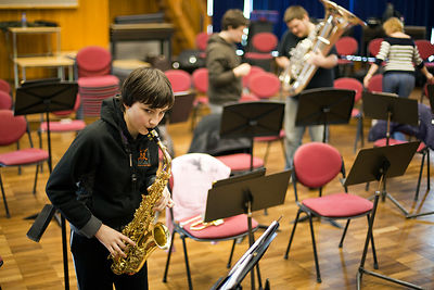 UK - Scunthorpe - Alex, 13 part of the Youth Concert Band practices his saxophone during a break in rehearsal of Cycle Song. John Leggot Centre