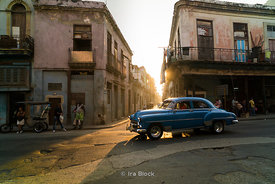 Old cars at sunrise on a street in Havana, Cuba.