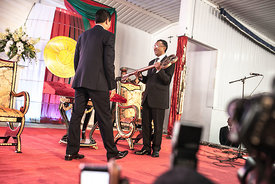Madagascar's newly elected President Hery Rajaonarimampianina (R) receives the key symbolising the transfer of power from outgoing president Andry Rajoelina during a handover ceremony at Iavoloha Presidential Palace in Antananarivo on January 24, 2014. Rajoelina stood down, symbolically handing over power ahead of his elected successor's inauguration, a move designed to steer the Indian Ocean island out of crisis.