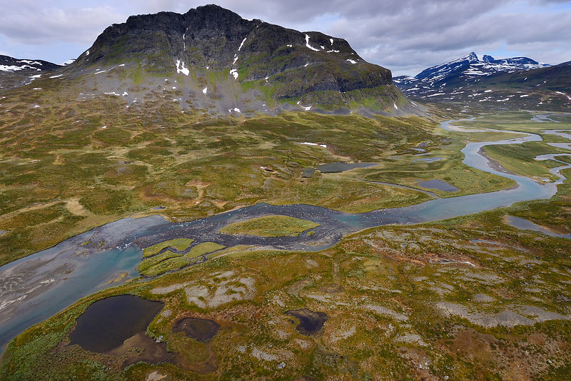 Aerial view of Vietasatno River near its source meandering through mountainous valley, Stora Sjofallet National Park, Greater Laponia Rewilding Area, Lapland, Norrbotten, Sweden, June 2013.
