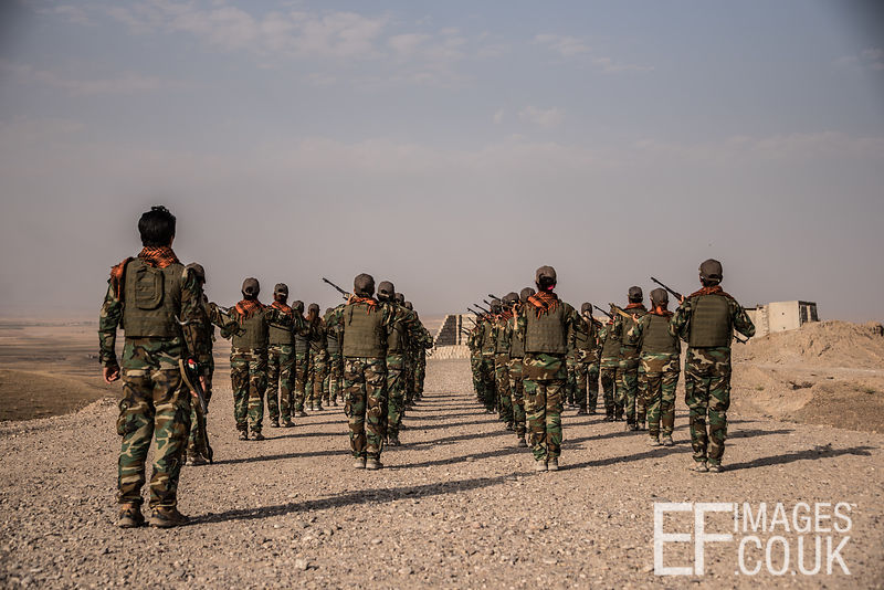 PAK (Kurdistan Freedom Party) female fighters during a training session at her base north of Hawija, where Kurdish Iranian fighters are holding the line against the last vestiges of Daesh and preparing to engage the Hashd al Shaabi forces threatening Kirkuk. Kirkuk Governorate, Iraq, 14th October 2017
