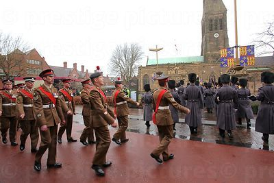 The Bearer Party Marching Behind The Queen's Division Band