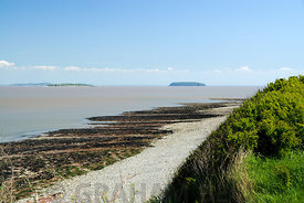 Bristol Channel with Flat Holm and Steep Holm Islands in the distance, Penarth, Vale of Glamorgan, South Wales, UK.