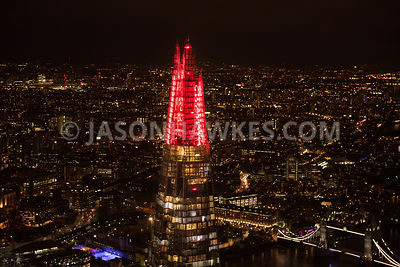 Aerial view of London, The Shard at night with River Thames towards Docklands.