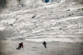 Skiers above crevasses