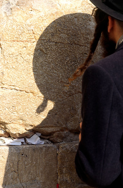 An Orthadox Jew prays at the 'Wailing' or Western Wall in Jerusalem