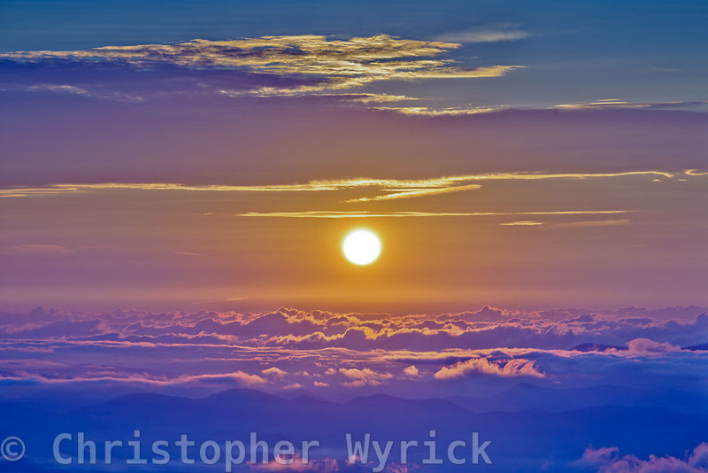 Epic sunrise captured with a Sony FE 70-200mm f/4 lens @ 200mm.  The true to life colors in this image make you feel like you are floating on top of the clouds.