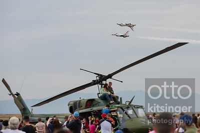 hanging out on top of a helicopter completely ignoring an air show