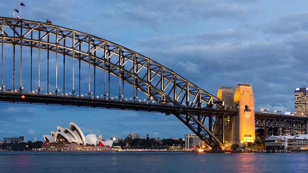 Medium Shot: Panning The Lighting Of Sydney Opera House & Harbor Bridge (Day to Night)