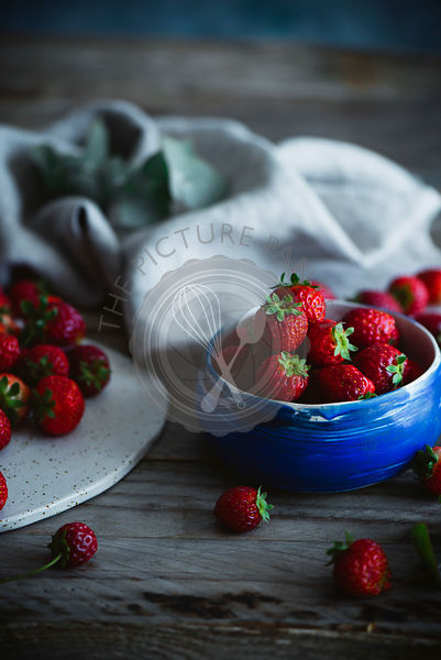 Strawberries in a rustic setting