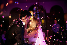 Romantic kiss of the bride and groom on the dancefloor