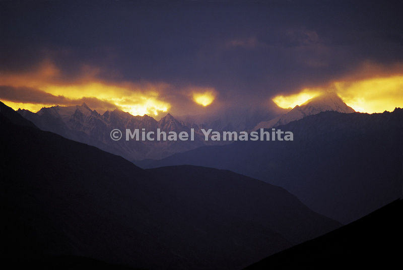 The sun sets beyond the mountains in Afghanistan.