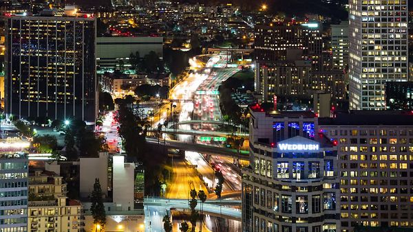 Bird's Eye: Panning Up Lights Of An Expressway Cutting Through Downtown L.A. High-Rises