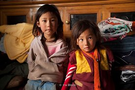 Brother and sister in Phobjika, Bhutan.  The young boy is a future lama.