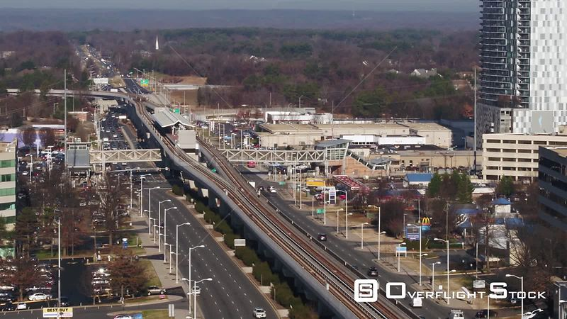 Tysons, Virginia, USA. Pedestal showing the Spring Hill Metro station and traffic on Leesburg Pike.