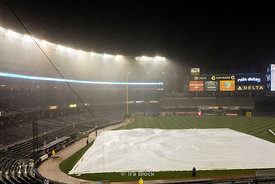 Yankee Stadium is a baseball venue located in the south Bronx in New York City. Because of a quick rain storm the game was stopped for a while.