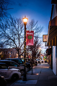 NNU students hang Christmas lights on poles in downtown Nampa