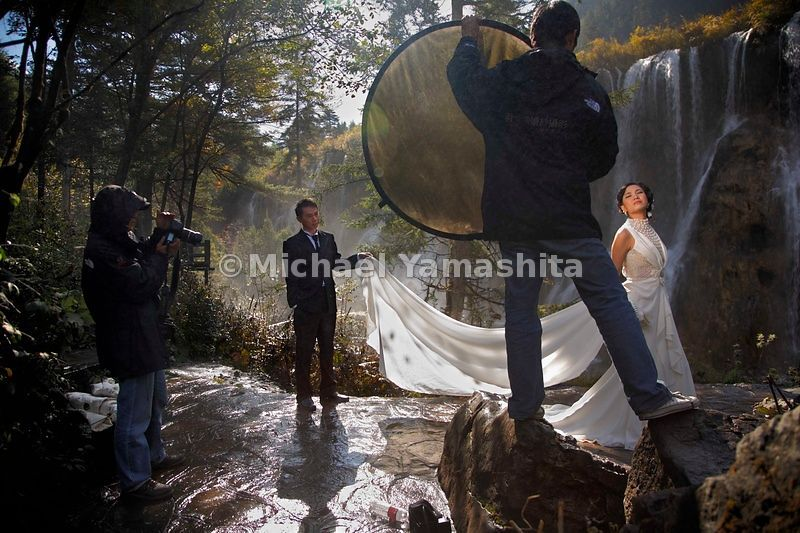 "Nuorilang means ""grand"" in Tibetan. Jiuzhaigou's Nuorilang Falls, cascading 80 feet down in the clear mountain light 7,700 feet above sea level, offers a suitably grand—and popular—backdrop for bridal photography."
