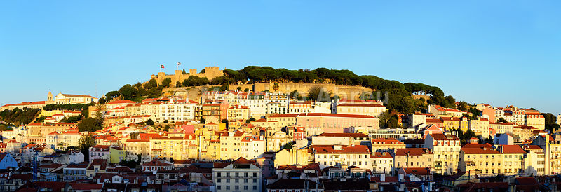 The historic centre and the São Jorge castle in the evening. Lisbon, Portugal
