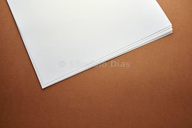 Detail of Notepad on White Paper in Brown Fund