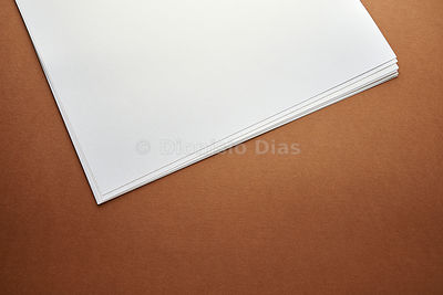 Detail of Notepad on White Paper in Brown Fund.