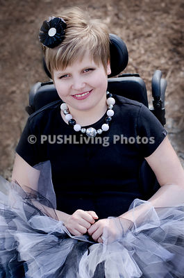 Portrait Of Disabled Girl Sitting On Wheelchair