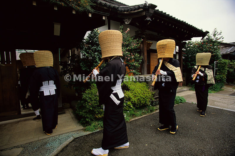 Recalling a form of begging adopted by masterless samurai called ronin, members of the Komuso Society walk in Tokyo playing bamboo flutes with their faces hidden. Ronin collected alms this way during the peaceful Edo period, wandering the countryside as humble monks.