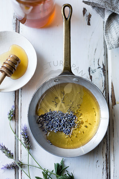 Honey and lavender buds in a pan