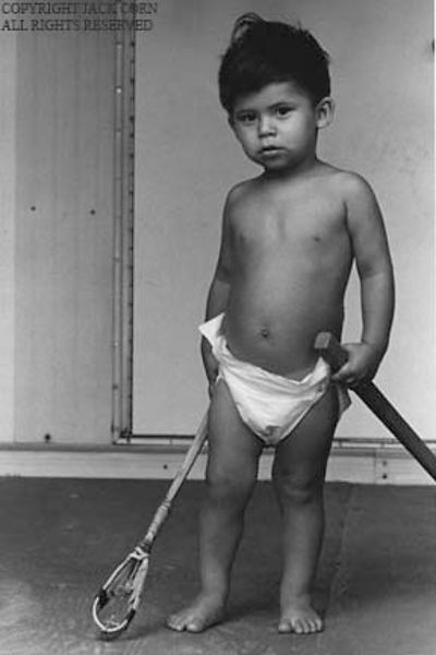 Choctaw child in pampers with game stick