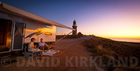 Couple watching sunset from Exmouth Lighthouse, Western Australia