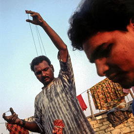 Puran Bhatt, a puppeteer on his roof. Puran is an international star with a master class every year in France.