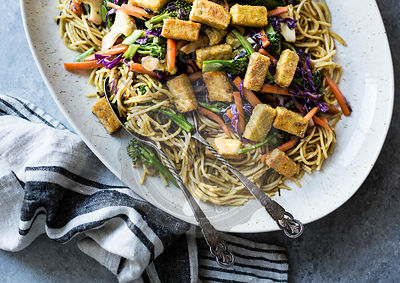 Curried noodles with crispy tofu & winter vegetables, gluten-free and vegan.