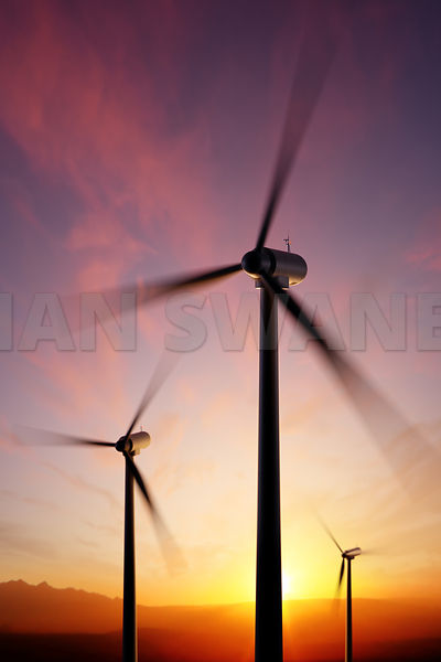 Wind Turbine blades spinning motion with golden sunset