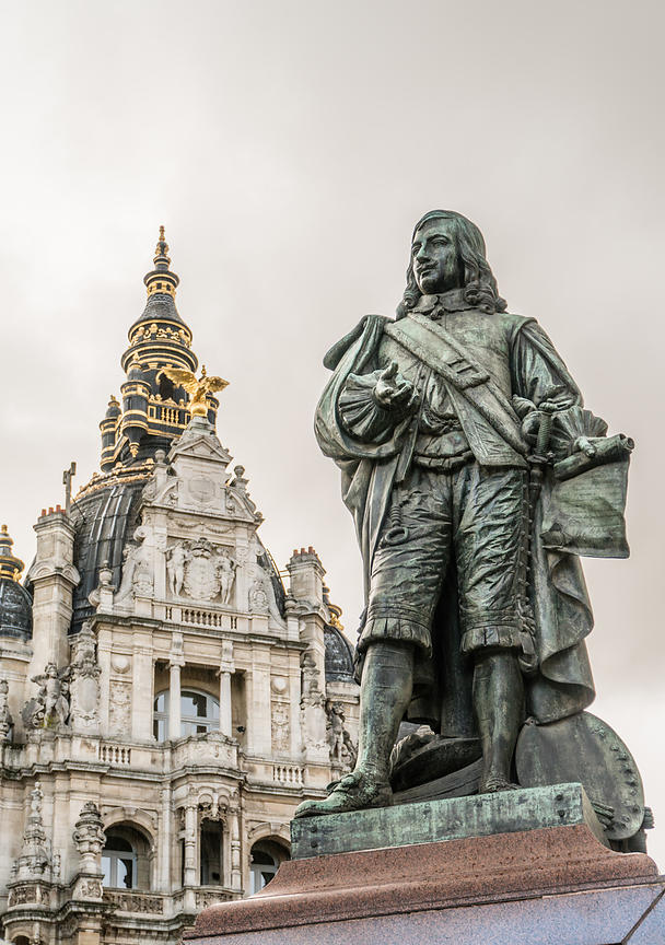 Statue of Flemish painter David Teniers the Younger against one of the impressing corner buildings at Teniersplaats in Antwerp, Belgium