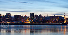 Montreal skyline at dusk, above the Saint Laurence river (fleuve Saint-Laurent)