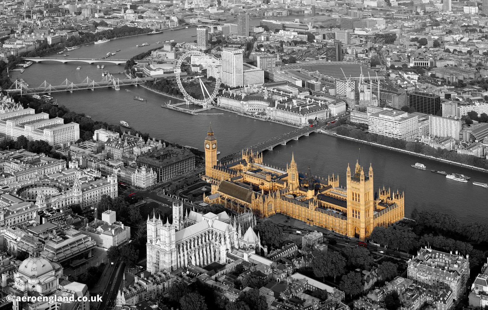 partial black and white aerial photograph of  London with the houses of Parliament in the foreground
