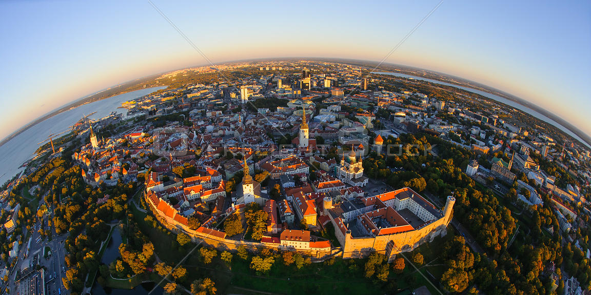 Aerial fisheye view Tallinn Old Town and City Centre at sunset. Harjumaa, Estonia, October 2013.