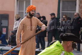 Sikh Man in an Orange Turban Rowing in the Venice Carnival Water Parade  on the Rio di Cannaregio Canal