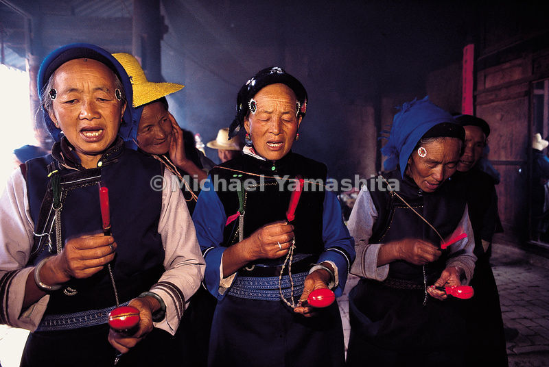 Once the rice crop is planted, the Bai tribe celebrates the Rao Shao Lin festival in Qindong Village in Dali.  Bai women pray for rain, a good harvest, money, and prosperity. China.