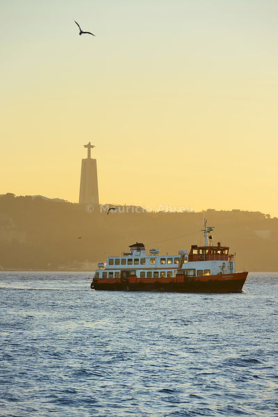 A traditional passenger boat (cacilheiro) crossing the Tagus river between Almada and Lisbon. Portugal