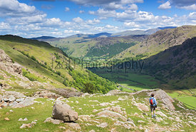 A hiker returning to Seathwait via Sour Milk Gill in the Lake District, UK.