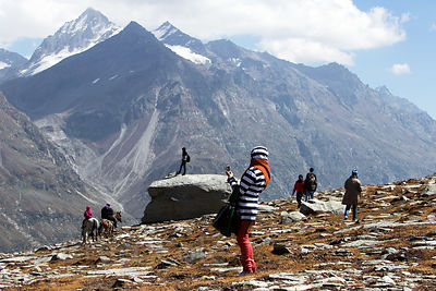 Indian tourists hike and take photos atop Rohtang Pass (13,054 ft., 3,979 m), Manali, India