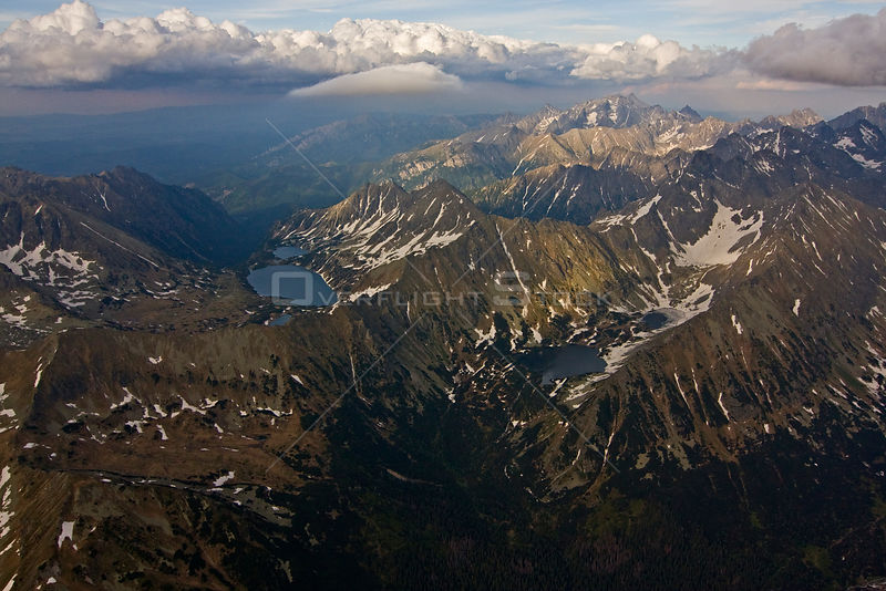 Aerial view of the High Tatras on the Carpathian Mountains, Slovakia-Poland border, Mount Gerlach (2,665m) in the distance, High Tatras, Carpathian Mountains, Slovakia, June 2009