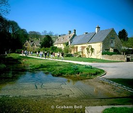group of ramblers and ford upper slaughter cotswolds gloucestershire england
