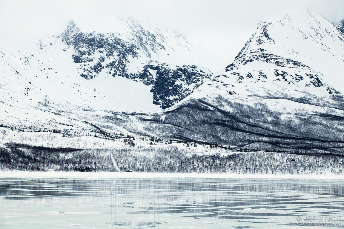 Mountains and half-frozen fjord