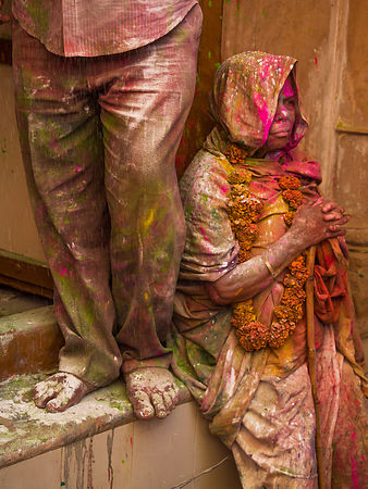 A widow looks deep in thoughts while praying during the holi celebrations in Vrindavan