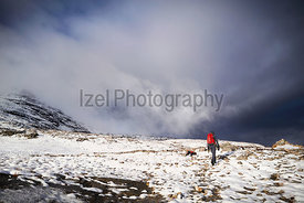 A hiker walking along the mountain path  route on Beinn Eighe, Scottish Highlands, Scotland, UK.