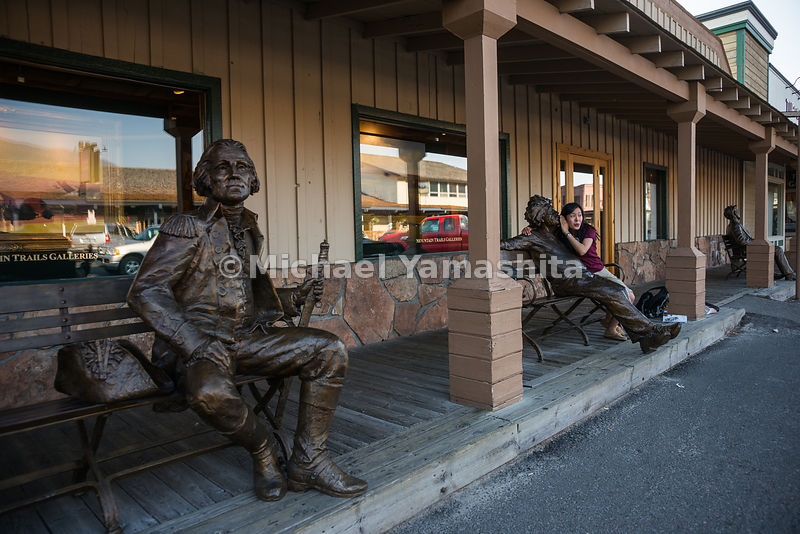 Bronze statues of historic figures such as George Washington and Albert Einstein in Town Square..Jackson, Wyoming...Jagged peaks of the Teton Range, lush meadows, dense forests and deep lakes, define this Park, which also teems with wildlife. Highest peak is 13,770ft., park encompasses 485sq. miles.